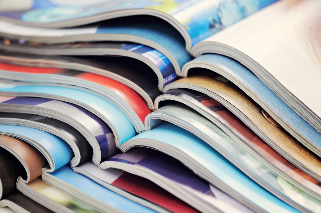Magazine pages arrayed in a cascade.