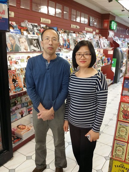 A photo of owners of Presse Internationale, Huashan Liu and Qing Yang.