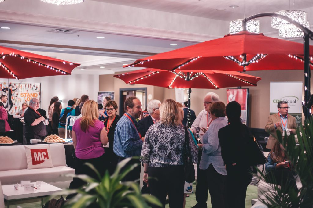 Photo of MagNet 2016 attendees socializing in MagNet Square, the conference networking space.