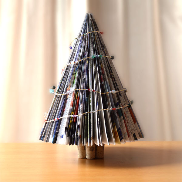 Photo of a Christmas tree made out of magazine pages.