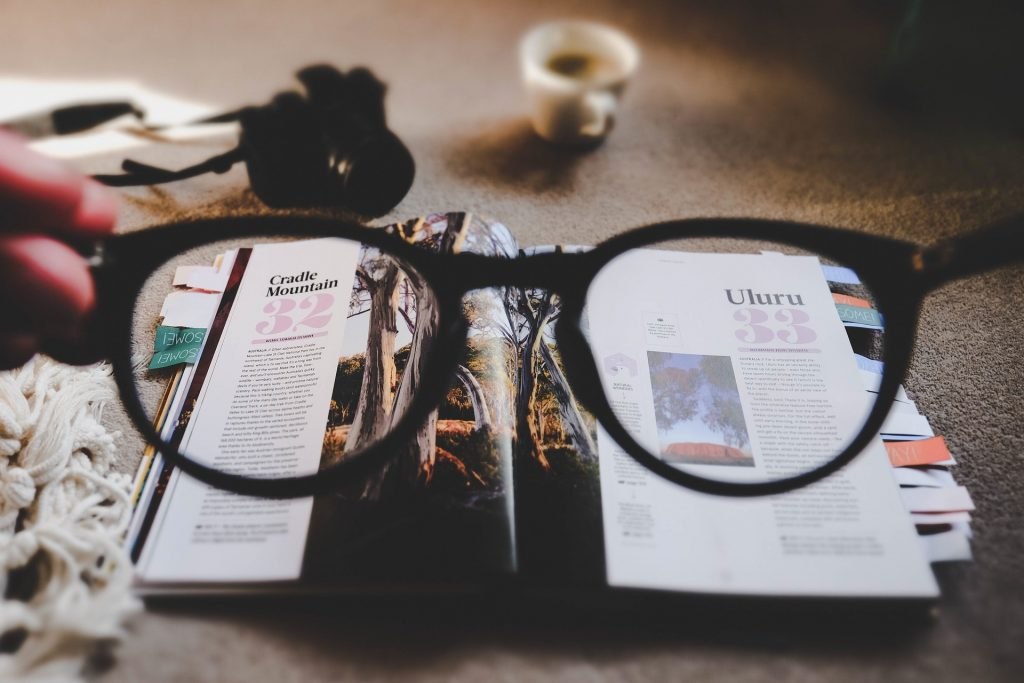 Magazine pages seen through a pair of eyeglasses
