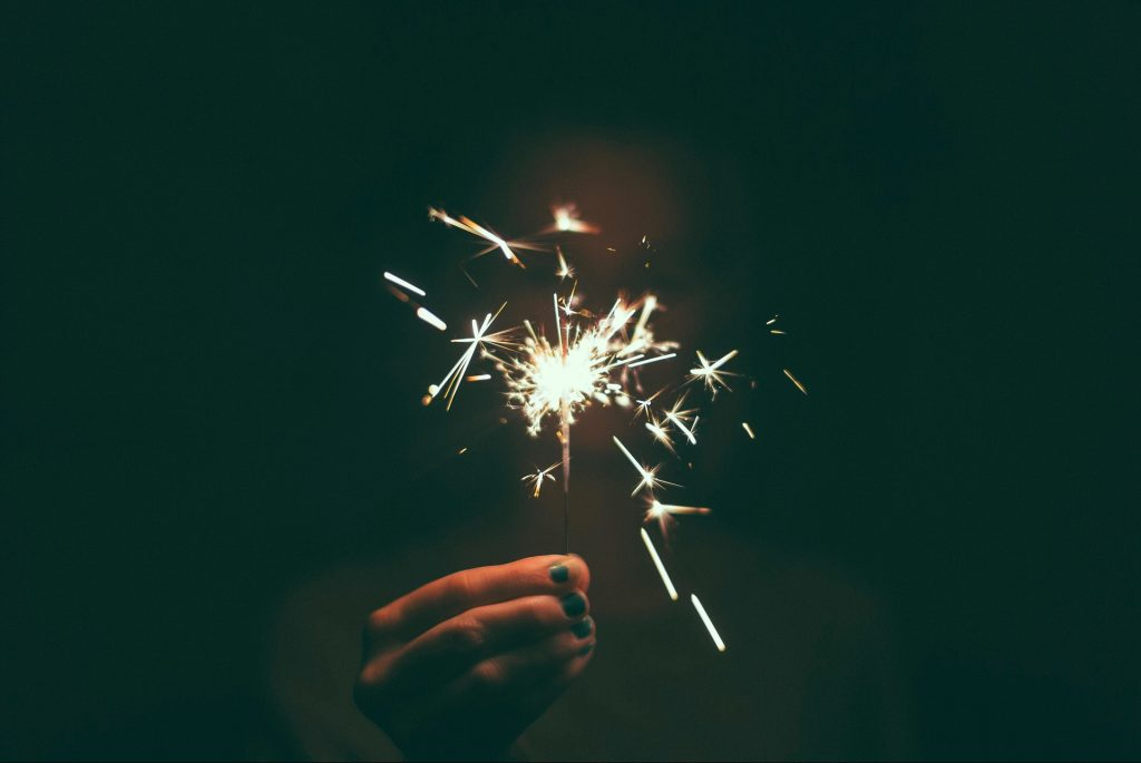 A sparkler held in the darkness celebrates the end of 2018 and the beginning of 2019.