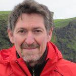 Headshot of webinar host Jim Handman