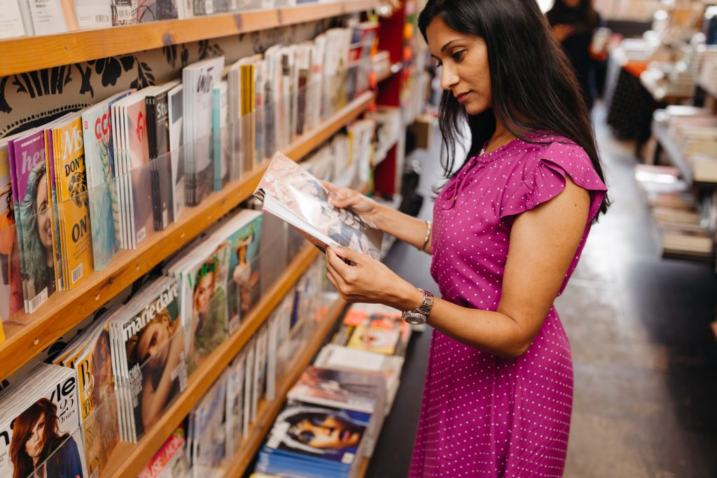 woman at magazine stand