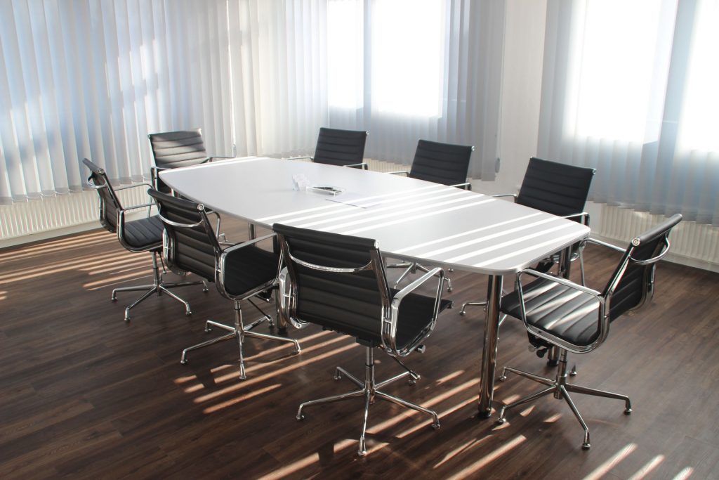 A board room table with chairs.